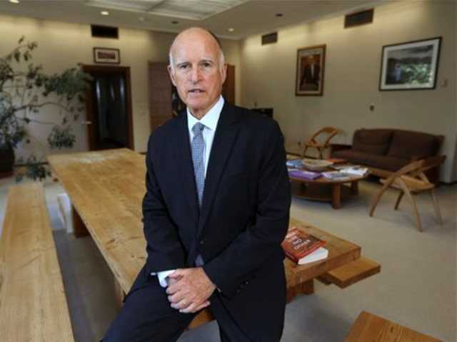Gov. Jerry Brown poses in his Capitol office in Sacramento, Calif. If Gov. Brown wins re-election in November, he will be given an unprecedented second opportunity to overhaul the California Supreme Court.