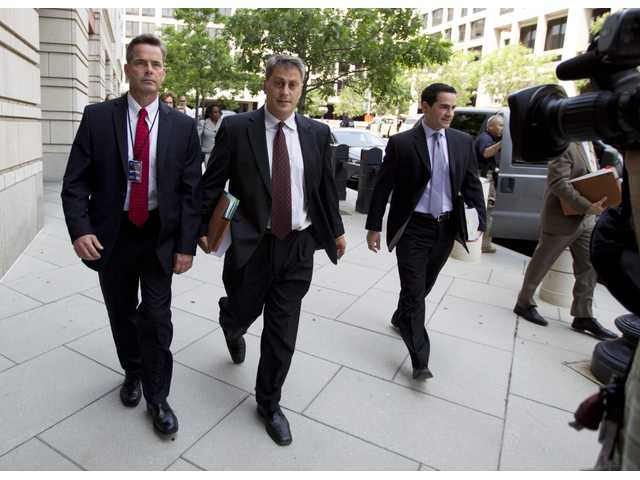 Assistant U.S. Attorney Michael DiLorenzo, center, enters the federal U.S. District Court in Washington Saturday, June 28,with his team.