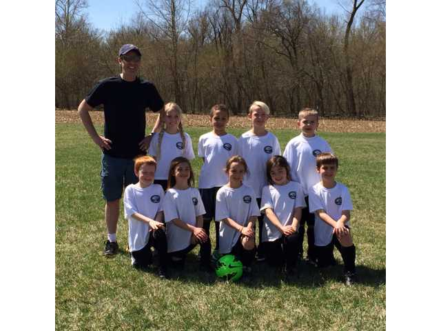 Jason Wright has coached his son's soccer team in the local peewee league.