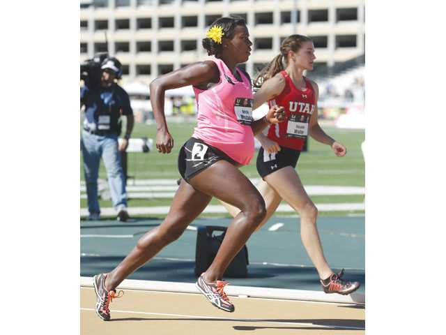 Alysia Montano, left, who is 34 weeks pregnant, competes in the quarterfinals of the 800 meters at the U.S. outdoor track and field championships in Sacramento on Thursday.