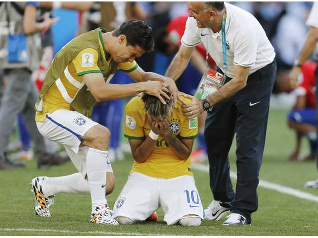 Brazil's Neymar holds his head after winning the penalty shoot between Brazil and Chile at Mineirao Stadium in Belo Horizonteon Saturday.
