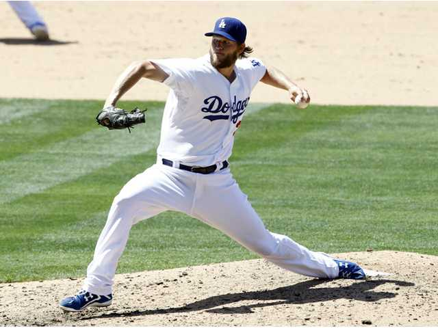 Los Angeles Dodgers pitcher Clayton Kershaw throws against the St. Louis Cardinals on Sunday in Los Angeles.