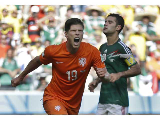 Netherlands' Klaas-Jan Huntelaar celebrates after scoring his side's second goal during the World Cup round of 16 soccer match between the Netherlands and Mexico.
