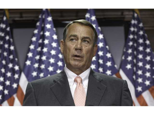 This June 24, 2014 file photo shows House Speaker John Boehner of Ohio speaking on Capitol Hill in Washington. Boehner told President Barack Obama that the House will not vote on overhauling the nation's troubled immigration system during this election year, the White House says. Officials say Obama will announce steps Monday to deal with immigration through executive actions without congressional approval. (AP Photo/J. Scott Applewhite, File)