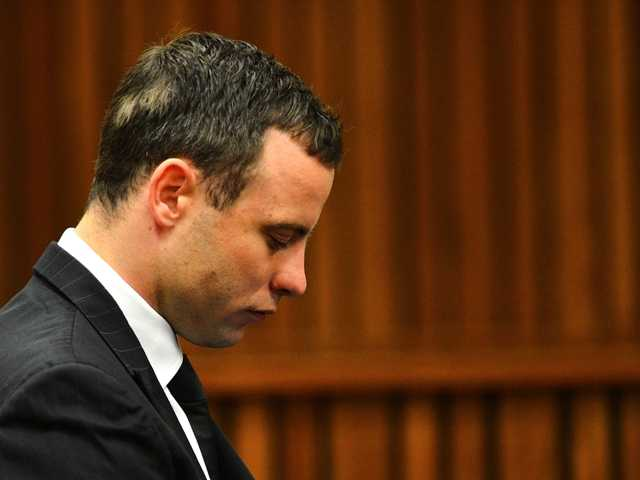 Oscar Pistorius listens to evidence in court in Pretoria, South Africa, June 30, 2014.