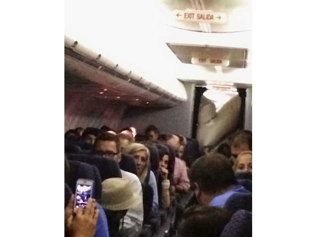 This Sunday, June 29, 2014 photo provided by Michael Schroeder shows an emergency chute after it inflated inside a United Airlines plane as it flew from Chicago to California, filling part of the cabin and forcing the pilot to make an emergency landing in Kansas. United Airlines officials said in a statement Monday, June 30, that no one aboard Flight 1463 was injured. (AP Photo/Michael Schroeder)