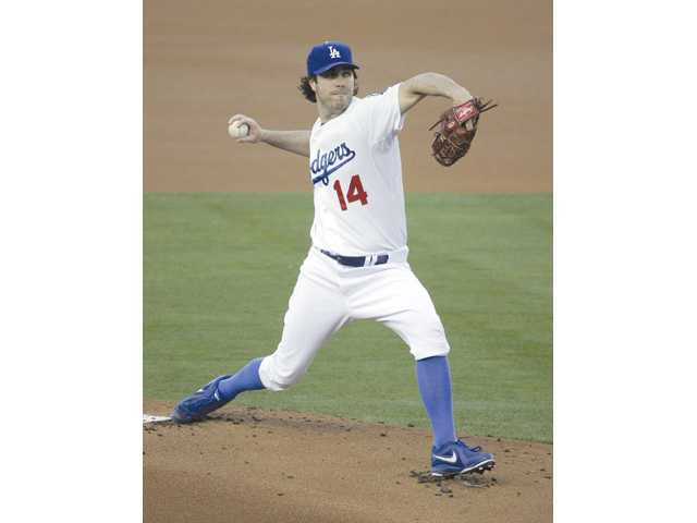 Los Angeles Dodgers starting pitcher Dan Haren throws to the Cleveland Indians in Los Angeles on Monday.