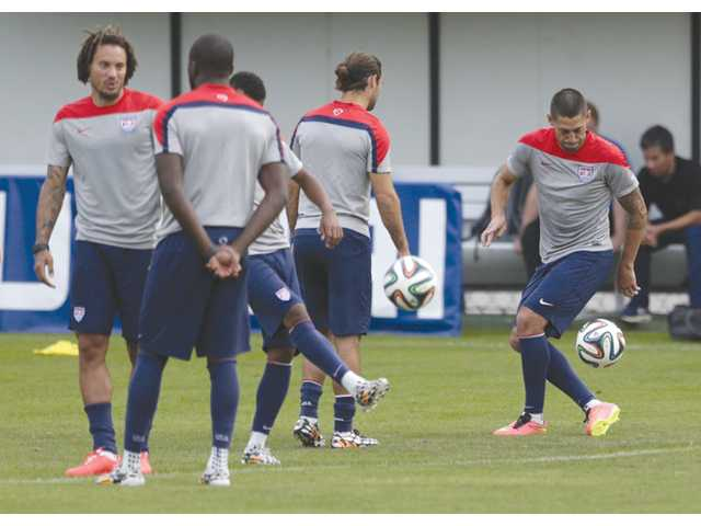 United States player Clint Dempsey, far right, works out during a training session in Sao Paulo, Brazil on Saturday ahead of the US team's World Cup game today.