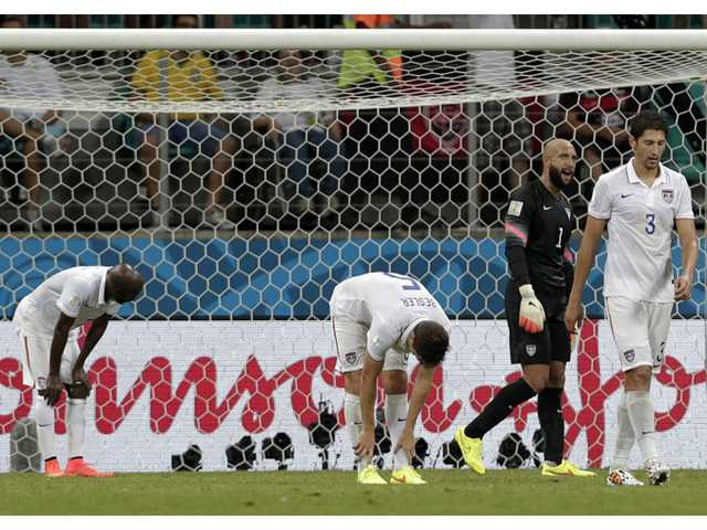 USA players react after Belgium's Romelu Lukaku scored during the World Cup round of 16 match in Salvador, Brazil on Tuesday.