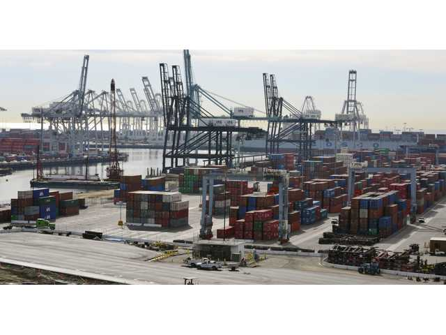 In this Jan. 10, 2011 file photo, shipping containers line the Port of Long Beach in Long Beach, Calif. The contract that keeps workers on the job at 29 West Coast ports expires Tuesday.