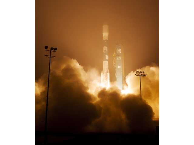 In this image released by NASA, a Delta 2 rocket with the Orbiting Carbon Observatory-2 satellite launches at Vandenberg Air Force Base, Calif.