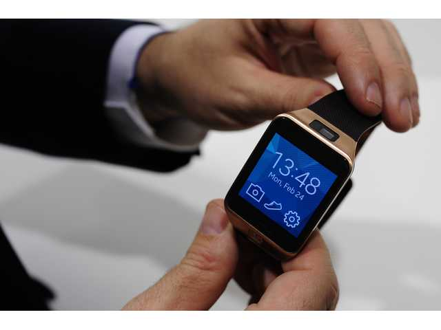 In this Feb. 24, 2014 file photo, the Samsung Gear 2 smartwatch is displayed at the Mobile World Congress in Spain