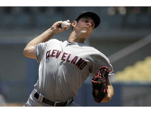 Cleveland Indians pitcher and Hart High graduate Trevor Bauer throws against the Los Angeles Dodgerson Wednesday in Los Angeles.