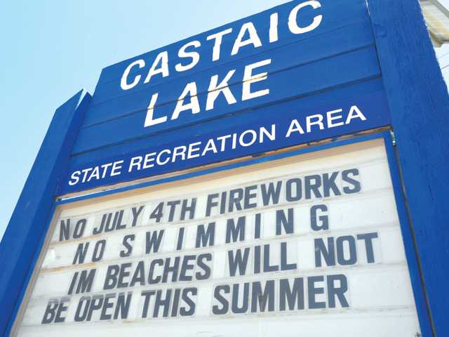 Low water levels in Castaic Lake have led to the cancellation of Fourth of July festivities and shut the beaches for swimming. Signal photo by Dan Watson