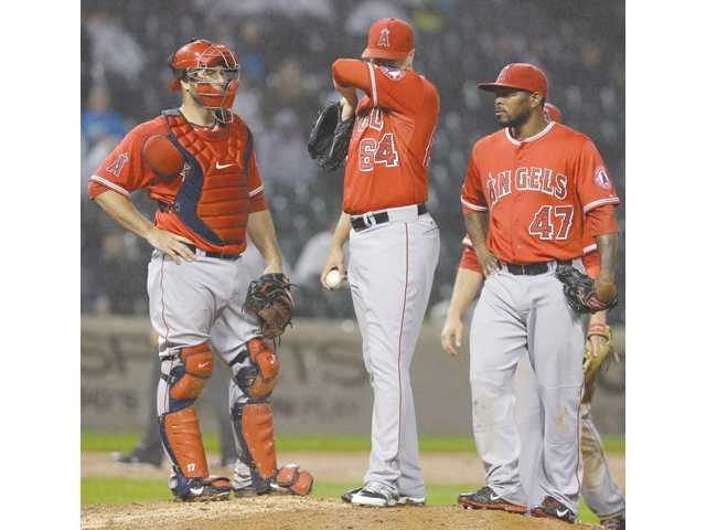 Los Angeles Angels relief pitcher Michael Morin (64), wipes his face as catcher during a game against the Chicago White Sox in Chicago on Wednesday.