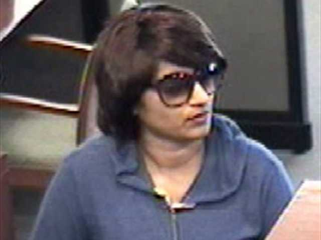 The FBI released photos Thursday of the woman suspected of robbing Bank of the West in Valencia last month.