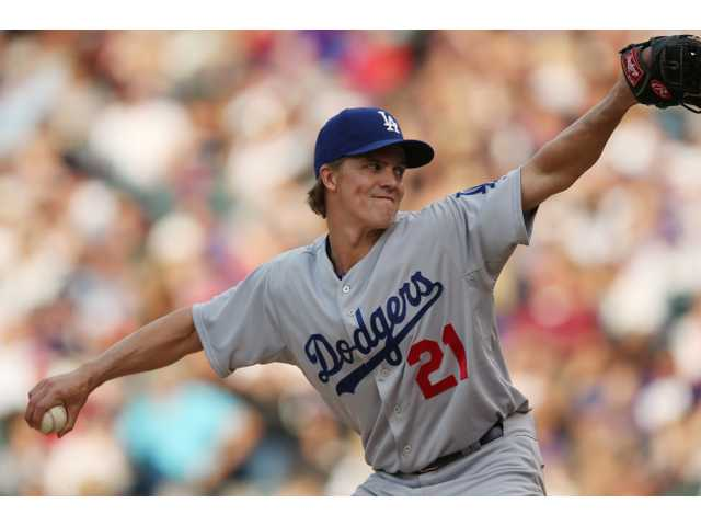 Los Angeles Dodgers staritng pitcher Zack Greinke works against the Colorado Rockies in the fourth inning of Thursday's game in Denver.