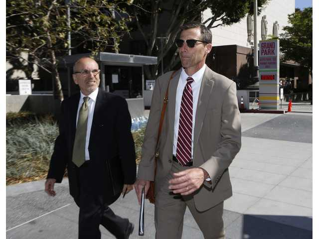 Two attorneys for former Los Angeles Dodgers owner Frank McCourt, Dana Fox, right, and Barry Hassenberg, leave Los Angeles Superior Court in Los Angeles on Wednesday, June 2, 2014