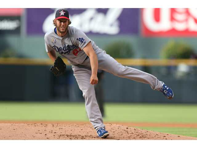 Los Angeles Dodgers starting pitcher Clayton Kershaw works against the Colorado Rockies in Denver on Friday.