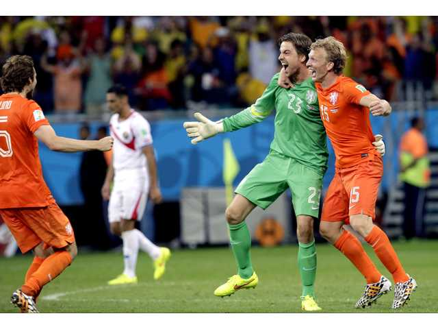 Netherlands' goalkeeper Tim Krul (23) celebrates with teammate Dirk Kuyt, right, after saving his second penalty kick during the World Cup quarterfinal soccer match between the Netherlands and Costa Rica at the Arena Fonte Nova in Salvador, Brazil on Saturday.