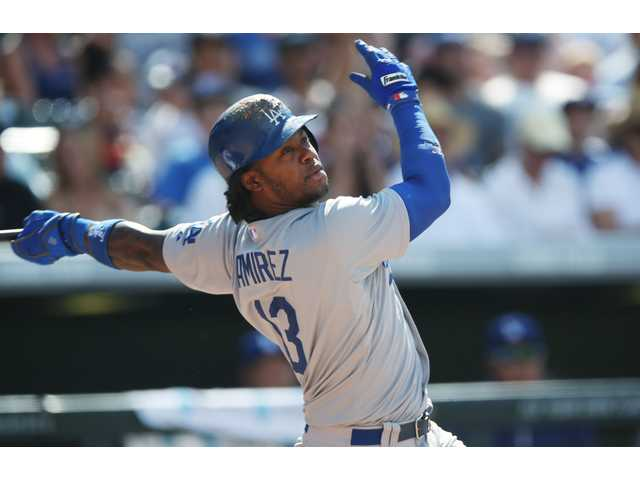 Los Angeles' Hanley Ramirez follows the flight of his RBI-single against the Colorado Rockies in the seventh inning of the Saturday's game in Denver.