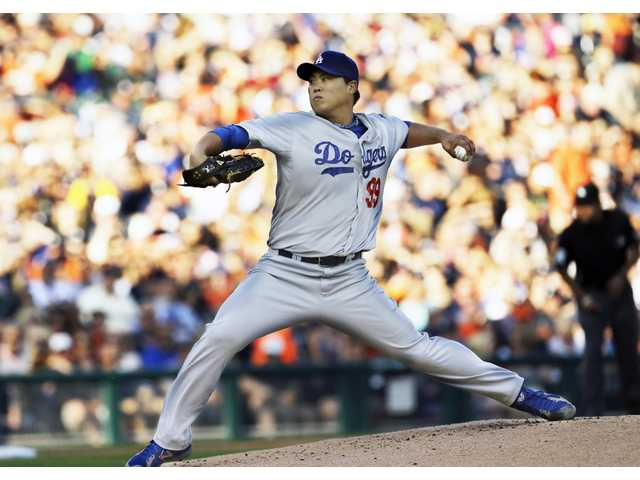 Los Angeles Dodgers pitcher Hyun-Jin Ryu throws against the Detroit Tigers in the first inning of Tuesday's game in Detroit.