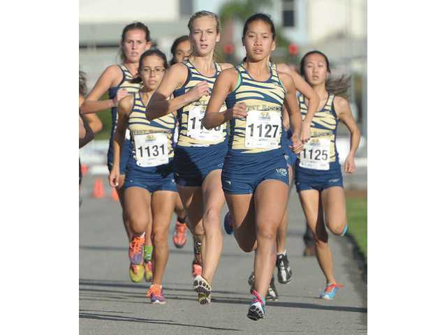 Marisa Magsarili, front, was West Ranch's top cross country runner and she also won the 800-meter and 1,600-meter track and field league titles.