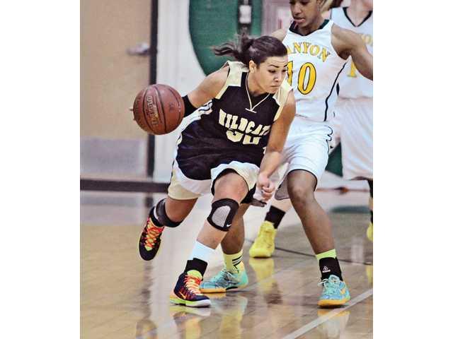 Whitney Branham averaged 22.7 points, 8.6 rebounds and 3.5 steals per game for the Wildcats' girls basketball team.