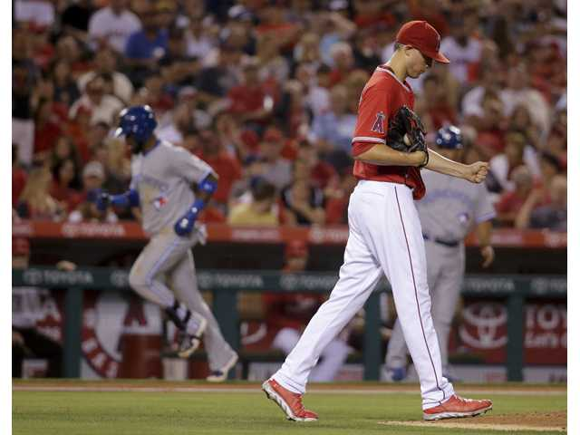 Toronto Blue Jays' Jose Reyes, left, rounds the bases after a two-run home run off Los Angeles Angels starting pitcher Tyler Skaggs in Anaheim on Tuesday.