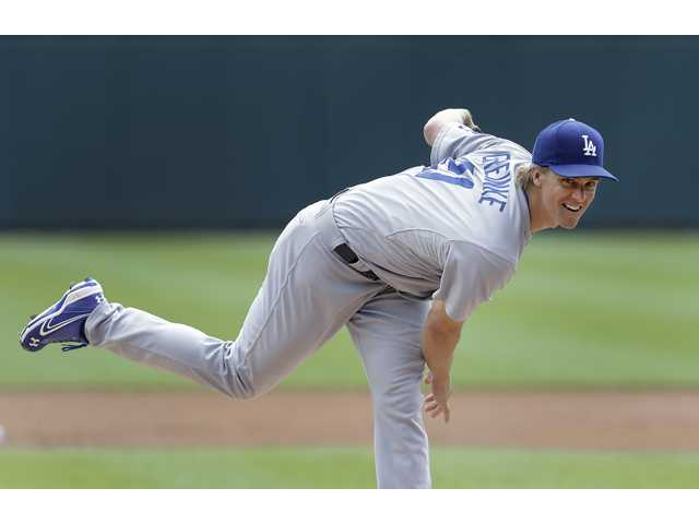 Dodgers pitcher Zack Greinke allowed three runs and seven hits in seven innings.