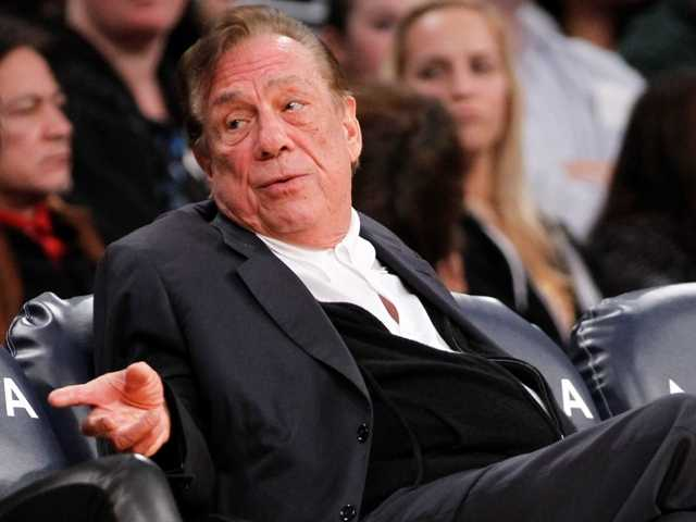 "Los Angeles Clippers owner Donald Sterling alternately kisses and her wife and calls hera ""pig"" while in court to determine whether she has the right to sellthe Clippers."