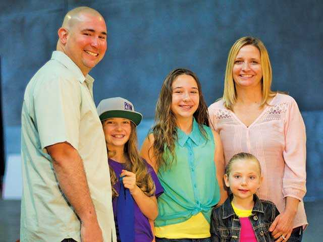 Local 11-year-old Kinsley White, second from left, a competitive snowboarder, is now a finalist for a $5,000 scholarship. Austin Dave / The Signal