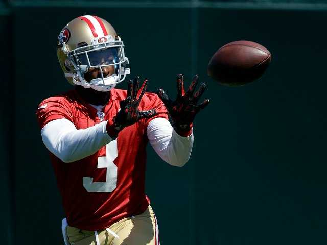 In this June 17, 2014, file photo, San Francisco 49ers wide receiver Bruce Ellington catches a pass during during NFL football minicamp in Santa Clara, Calif. Gone are the days when Bruce Ellington would rush from a basketball workout with South Carolina teammates to a football meeting room to learn the complex schemes of coach Steve Spurrier. Ellington's only focus is the San Francisco 49ers and making an impact on the NFL. (AP Photo/Jeff Chiu, File)