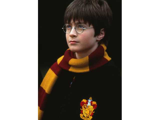"Daniel Radcliffe as Harry Potter in ""Harry Potter and the Sorcerer's Stone."""