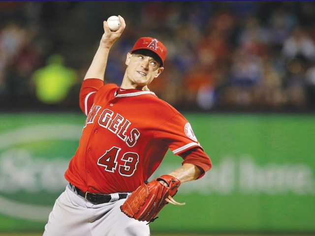 Los Angeles Angels starting pitcher Garrett Richards delivers to the Texas Rangers on Friday in Arlington, Texas.