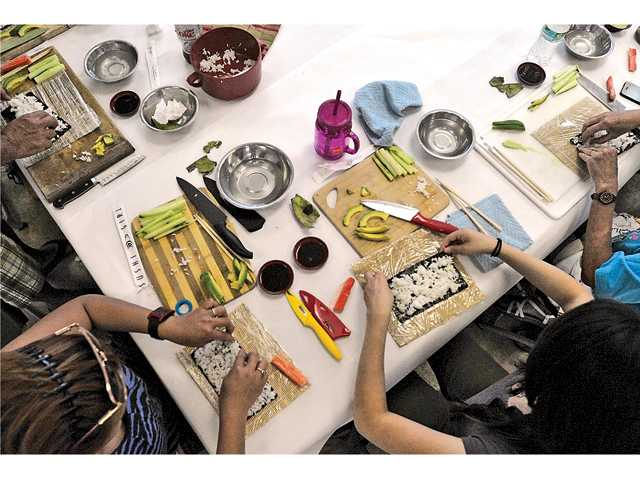 Students prepare their sushi rolls in a sushi-making class at Canyon Country Park on Saturday. Signal photo by Katharine Lotze.