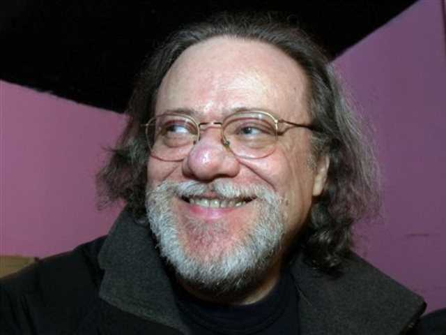 In this Jan. 8, 2005, file photo, Tommy Ramone, ex-drummer and manager of The Ramones, smiles as he is interviewed backstage at the Knitting Factory in New York.