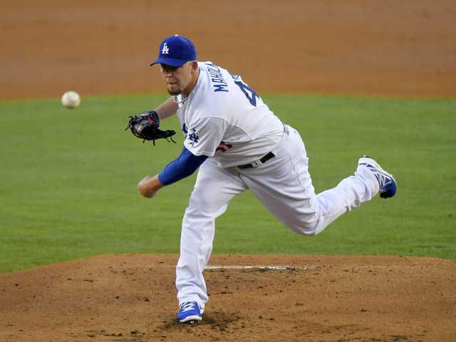 Los Angeles Dodgers relief pitcher Paul Maholm throws against the San Diego Padres on Saturday in Los Angeles.