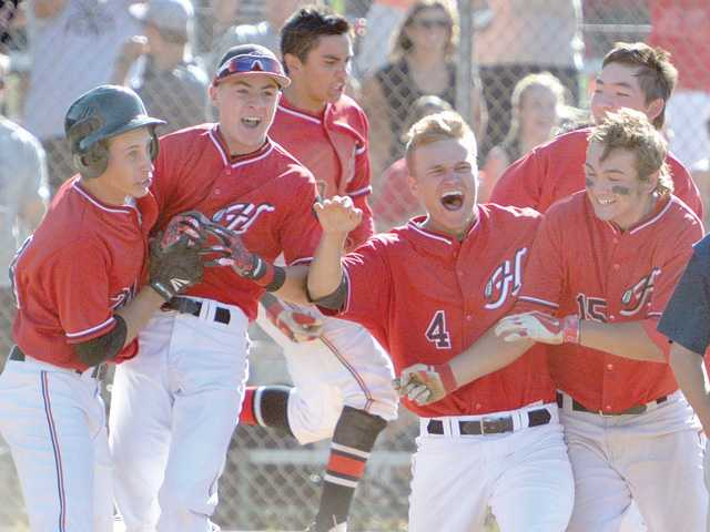 The Hart baseball team rejoices after securing a Foothill League championship.
