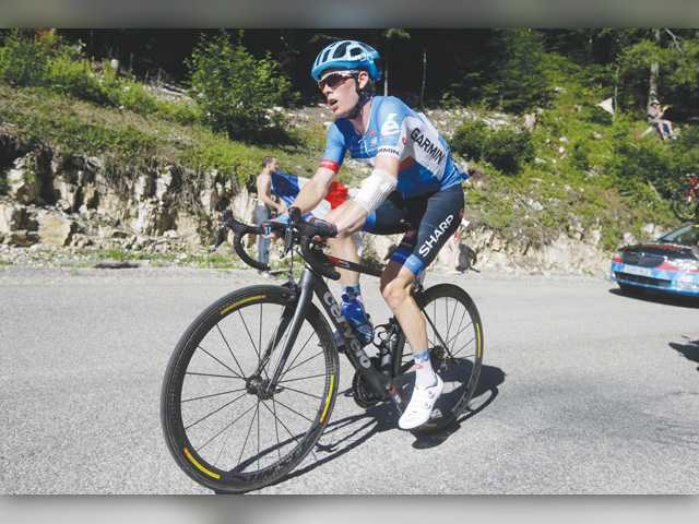 American rider Andrew Talansky races nearly 20 minutes delay on the pack because of back pain during the Tour de France in Oyonnax, France on Wednesday.