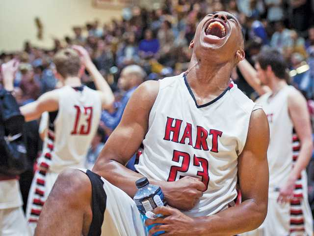 Hart basketball player Lewis Stallworth reacts after his team clinched the Foothill League title.