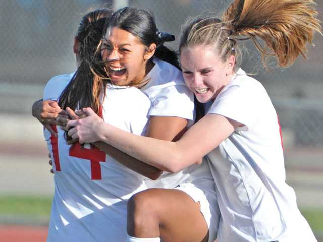 Members of the Hart girls soccer team celebrate a win in the CIF-SS Division II semifinals.