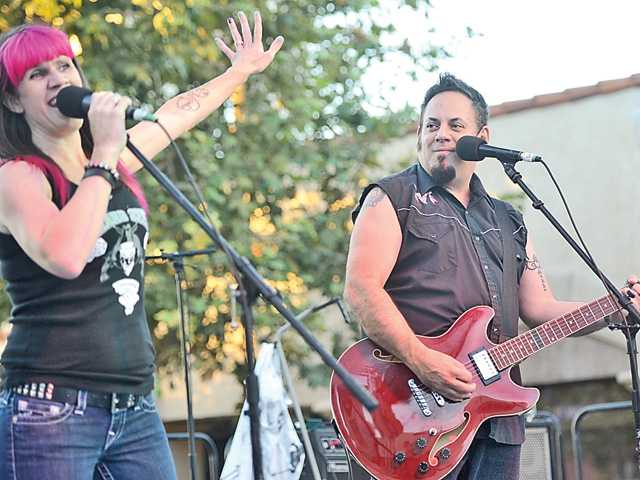 "The Hard Six perform ""Jackson"" by Johnny Cash  in downtown Newhall on Thursday. An estimated 2,000 people attended the rockabilly-themed event. Signal photo by Katharine Lotze."