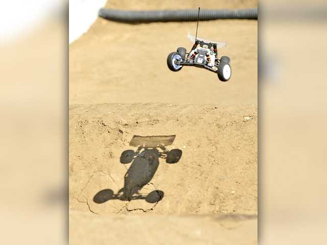 A car rolls over during a practice run at the Hot Rod Hobbies racetrack on Thursday as drivers practice for the SCV's biggest RC car race this weekend. Photo by Katharine Lotze/Signal