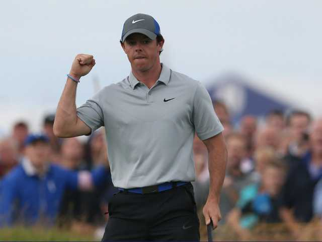 Rory McIlroy celebrates after making an eagle on the 16th hole during the third day of the British Open in Hoylake, England on Saturday.