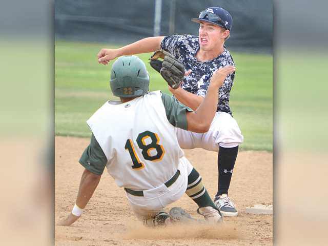 Saugus' Brendan Griffith, right, waits for the ball as he makes the tag on Canyon baserunner Mike Santillan in the fifth inning at Saugus High on Saturday.