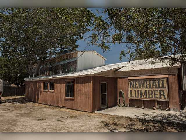 The former Newhall Lumber yard and building was sold for an undisclosed amount to local private investors on July 7. Courtesy photo