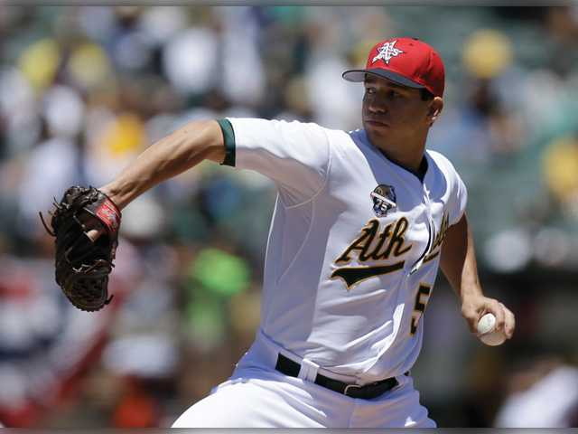 Oakland Athletic and Saugus graduate Tommy Milone works against the Toronto Blue Jays in the first inning on July 4 in Oakland.
