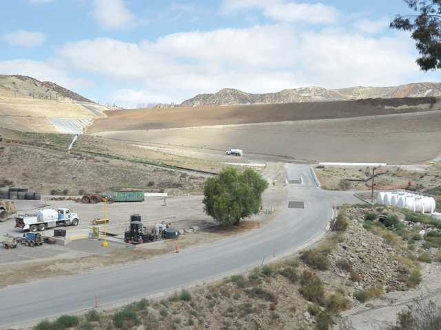 A truck moves up a work road leading through the proposed expansion site in the foreground at the Chiquita Canyon Landfill. Signal photo by Dan Watson