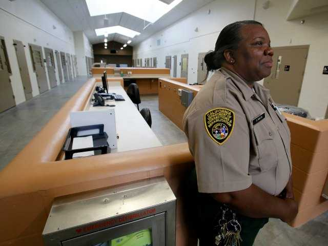Correctional Officer Stella Miles stands in one of the secure inmate-patient housing units of the new California Correctional Health Care Facility in Stockton, Calif.